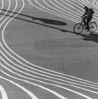Man biking on striped surface